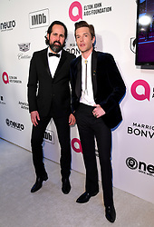 Ronnie Vannucci Jr and Brandon Flowers of The Killers attending the Elton John AIDS Foundation Viewing Party held at West Hollywood Park, Los Angeles, California, USA.