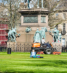 Pictured: Lone Sunbather<br /> <br /> The sunshine brought out a lone sunbather into the gardens in Charlotte Square in Edinburgh today. Rumours that she was keen to get awat from the Election fervour have yet to be confirmed.<br /> <br /> <br /> <br /> Ger Harley | EEm 20 April 20162016