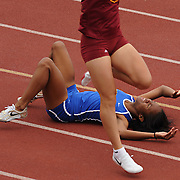 4/11/09 5:22:38 AM --- TRACK AND FIELD SPORTS SHOOTER ACADEMY 006 --- Alysha Turner, a sophomore at West Los Angeles College, falls to the ground after a failed baton pass at the Orange Coast Track and Field Classic at Orange Coast College in Costa Mesa, Calif. on April 10, 2009.