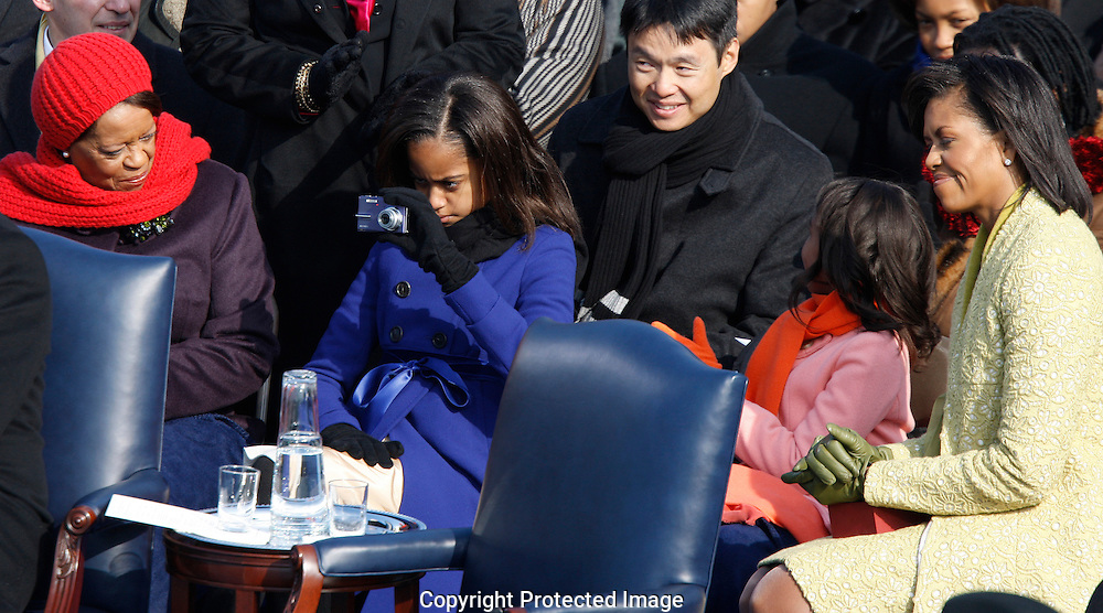 Malia takes a photo of her father Delivering his Inaugural Address.at the swearing in ceremony during the Inauguration on January 20, 2009.  Photograph:  Dennis Brack