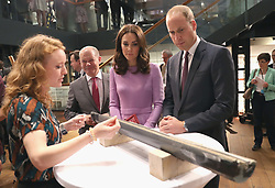The Duke and Duchess of Cambridge are shown a core sample from under the sea during a visit to the Maritime Museum in Hamburg, Germany.