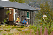 Luke Nelson and Krissy Moehl getting ready for another day on the trail, Kaitumjaure, Kings Trail in artic Sweden. Day 1