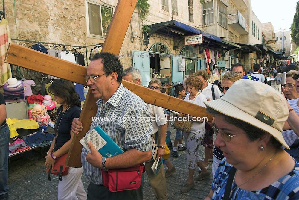 Israel, Jerusalem, Pilgrims bearing a Cross at a Via Dolorosa Procession,