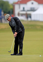 Robert Rock plays his third shot on the first green during day two of the Betfred British Masters at Hillside Golf Club, Southport.