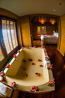 Interior view of an overwater bungalow, Four Seasons Resort Bora Bora, French Polynesia.