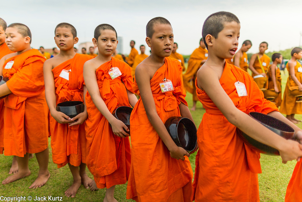 """23 APRIL 2013 - BANGKOK, THAILAND:   Buddhist monks and novices file into the opening ceremony to mark Bangkok as the World Book Capital City 2013. UNESCO awarded Bangkok the title. Bangkok is the 13th city to assume the title of """"World Book Capital"""", taking over from Yerevan, Armenia. Bangkok Governor Suhumbhand Paribatra announced plans that the Bangkok Metropolitan Administration (BMA) intends to encourage reading among Thais. The BMA runs 37 public libraries in the city and has modernised 14 of them. It plans to build 10 more public libraries every year. Port Harcourt, Nigeria will be the next World Book Capital in 2014..PHOTO BY JACK KURTZ"""