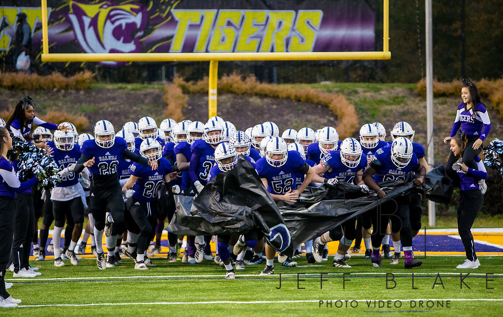 Saluda Tigers players make their entrance before the game against the Barnwell Warhorses in the Class AA State Championship game. 2019 Saluda State Championship Football Photos