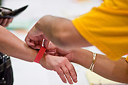 Nov. 11, 2009 -- PHOENIX, AZ: Union members check in and get wrist bands giving them admission to the meeting before a meeting of members of the UFCW at the Airport Marriott Hotel in Phoenix. The United Food and Commercial Workers Union (UFCW) Local 99 has about 25,000 members in Arizona: 15,000 in Fry's grocery stores and Fry's Marketplace, 9,500 in Safeway stores and 400 in Smith's grocery stores. The union voted down the last proposal from the stores and has announced plans to go on strike at 6PM on Friday, Nov. 13. The meeting Wednesday is the last one before the strike.   Photo by Jack Kurtz