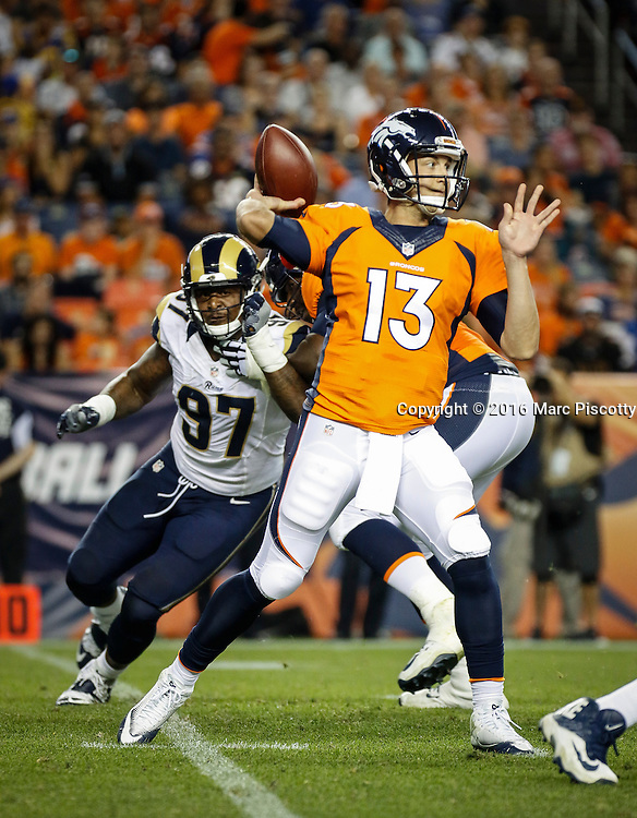 Denver Broncos quarterback Trevor Siemian (#13) drops back to pass while playing against the Los Angeles Rams at Sports Authority Field at Mile High in Denver, Co. August 27, 2016. (Photo by Marc Piscotty / © 2016)