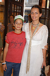 Model SAFFRON ALDRIDGE and her son MILO ASTAIRE at a party to celebrate the publication of iPod, Therefore I am by Dylan Jones held at Asprey, 169 New Bond Street, London W1 on 14th July 2005.<br /><br />NON EXCLUSIVE - WORLD RIGHTS