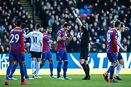 Crystal Palace #4 Luka Milivojević  talk to referee Kevin Friend during the Premier League match between Crystal Palace and Tottenham Hotspur at Selhurst Park, London, England on 25 February 2018. Picture by Sebastian Frej.