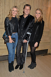 ANDREW CASTLE and his daughters Left GEORGINA CASTLE and right CLAUDIA CASTLE at the opening night of Cirque du Soleil's award-winning production of Quidam at the Royal Albert Hall, London on 7th January 2014.