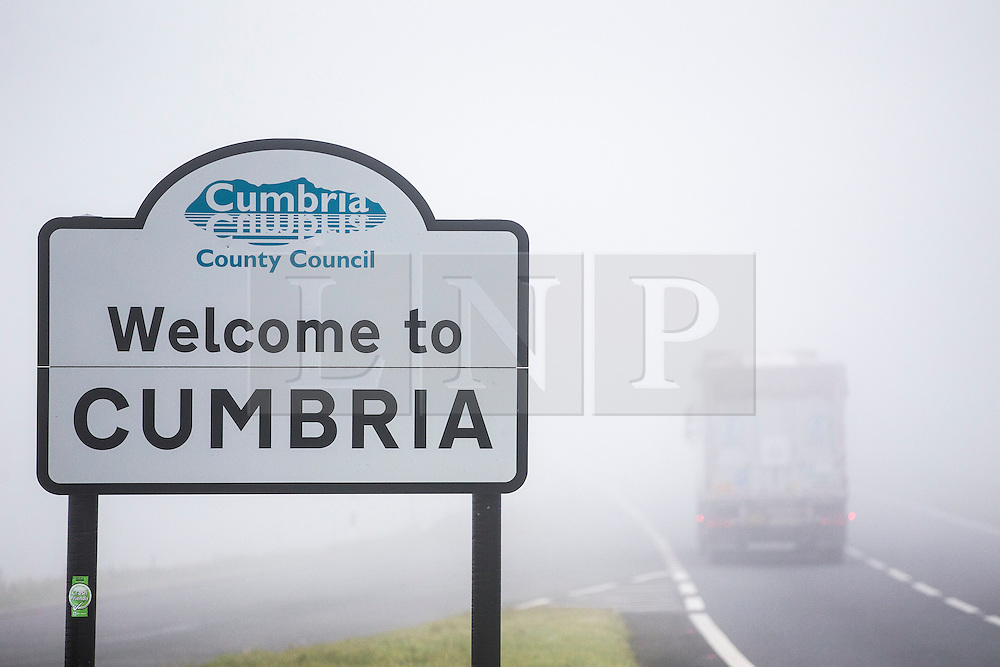 © Licensed to London News Pictures. 14/09/2016. Appleby UK. Picture shows drivers struggling in thick fog on the A66 in Cumbria. While some parts of the country enjoy another day of sunshine Cumbria has been covered by a thick blanket of fog. Photo credit: Andrew McCaren/LNP
