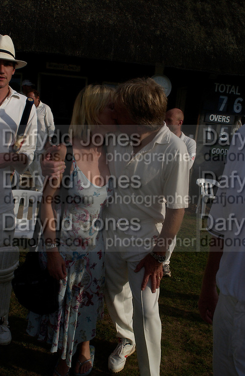 Nettie Mason and Derek Bell, The Duke of Richmond and Gordon's X1 V The Earl of March and Kinrara's X1. Cricket match before the Goodwood Revival meeting, 2 September 2004. SUPPLIED FOR ONE-TIME USE ONLY-DO NOT ARCHIVE. © Copyright Photograph by Dafydd Jones 66 Stockwell Park Rd. London SW9 0DA Tel 020 7733 0108 www.dafjones.com