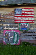 An American Flag and heads painted on panels, part of the Heidelberg Project, a folk art installation taking up over two city blocks in Detroit started by artist Tyree Guyton. The Heidelberg Project an outdoor art installation in Detroit, Michigan started in 1986 has become a tourist attraction.