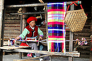 China, Woman works at her loom