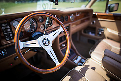© Licensed to London News Pictures. 07/08/2016. Leeds UK. Picture shows the dashboard of a white convertible Rolls Royce Corniche 2 at the 37th Rolls Royce North rally that has taken place this weekend in the ground's of Harewood House in Yorkshire. The event bring's together some of the UK's most prized motor cars & their proud owners. Photo credit: Andrew McCaren/LNP