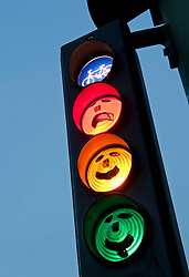 faces drawn onto cycle traffic lights at dusk in Berlin Germany