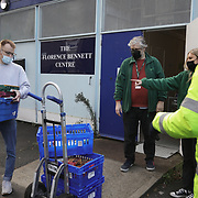 Workers and volunteers at Hackney Foodbank bank receive and organize food donations, 15th of December 2021, Hackney, East London, United Kingdom. The Hackney Foodbank is part of a nationwide network of foodbanks, supported by The Trussell Trust, working to combat poverty and hunger across the UK. The food bank gives out three days emergency food supplies to families and individual who go hungry in the borrough. The food is all donated by individuals and the food donated is held in a small ware house where it is  sorted and packed for distribution.  More people than ever in Britain have turned to the food bank for help and in Hackney the need has gone up with 350% over the past two years. (photo by Kristian Buus/In Pictures via Getty Images)