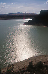 Embalses del Guadalhorce  Reservoir; showing sun reflected in the water,