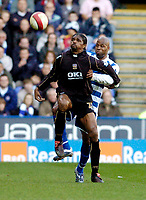 Photo: Leigh Quinnell.<br /> Reading v Portsmouth. The Barclays Premiership. 17/03/2007. Portsmouths Nwankwo Kanu backs into Readings Michael Duberry.