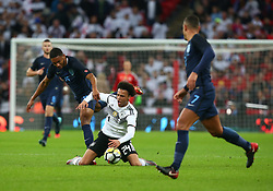 November 10, 2017 - London, England, United Kingdom - Leroy Sane of Germany   gets tackled by England's Joe Gomez..during International Friendly match between England  and Germany  at Wembley stadium, London  on 10 Nov  , 2017 ..during International Friendly match between England  and Germany  at Wembley stadium, London  on 10 Nov  , 2017  (Credit Image: © Kieran Galvin/NurPhoto via ZUMA Press)