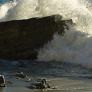 Wave crashing on rock. Zuma Point. Malibu, CA.USA.