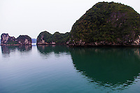 Halong Bay is a UNESCO World Heritage Site, and a popular travel destination near Hanoi, Vietnam.  The bay features thousands of limestone karsts islands and isles of various sizes and shapes. Halong bay is divided into several administrative zones.  These larger zones share similar characters in terms of  geology, geography and climate.