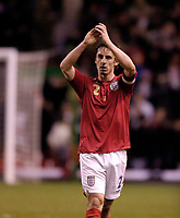 Photo: Jed Wee.<br /> England v Uruguay. International Friendly. 01/03/2006.<br /> <br /> England's Gary Neville applauds the fans after the Kop spent time singing his name, although there was scattered booing during the game.