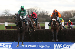 Impulsive Star ridden by Sam Waley-Cohen (right) trail Callet Mad ridden by James Bowen over the last fence before going on to win The MCCoy Contractors Civil Engineering Classic Handicap Steeple Chase Race run at Warwick Racecourse.