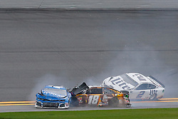 February 10, 2019 - Daytona, FL, U.S. - DAYTONA, FL - FEBRUARY 10: Kyle Larson, driver of the #42 Credit One Bank Chevy,  and Kyle Busch, driver of the #18 M&MÃ•s Chocolate Bar Toyota, collide during the Advance Auto Parts Clash on February 10, 2019 at Daytona International Speedway in Daytona Beach, FL. (Photo by David Rosenblum/Icon Sportswire) (Credit Image: © David Rosenblum/Icon SMI via ZUMA Press)