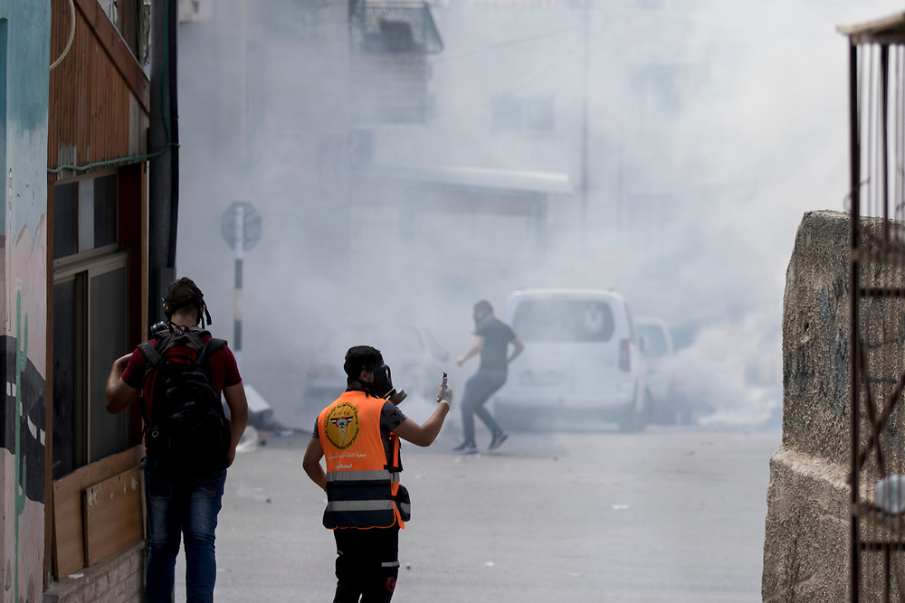 Bethlehem, Palestine. 15 May 2018. Streets filled with tear gas during clashes with Israeli soldiers on the 70th anniversary of the Nakba (Catastrophe) when over 700,000 Palestinians were forcibly moved from their homes during the creation of Israel. © Craig Redmond