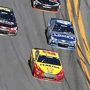 Sprint Cup Series driver Joey Logano (22) leads Jeff Gordon (24) and Jimmie Johnson (44) during the 57th Annual NASCAR Daytona 500 race at Daytona International Speedway on Sunday, February 22, 2015 in Daytona Beach, Florida.  (AP Photo/Alex Menendez)