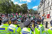 Police officers some of them wearing face masks stand by at Parliament Square during an Extinction Rebellion climate change protest in London, Tuesday, Sept 1, 2020. (VXP Photo/ Vudi Xhymshiti)