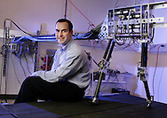 James Schmiedeler, professor of mechanical engineering at Ohio State, with his bipedal planar robot named ERNIE. (Will Shilling/Alive)