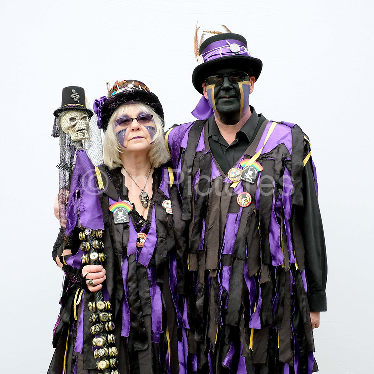 Portrait of Rackaback Morris dancers wearing traditional costume at an orchard-visiting wassail at Sledmere House in the Yorkshire Wolds, United Kingdom on 20th January 2018. Wassail is a traditional Pagan winter celebration in cider-producing regions of England, reciting incantations and singing to the trees to promote a good harvest for the coming year. Pieces of toast soaked in cider are hung in the branches to attract robins to the tree as these are said to be the good spirits of the orchard. To ward off evil spirits, villagers scare them away by banging pots and pans and making as much noise as possible