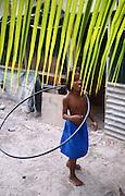 A girls plays with a hula-hoop in Tarawa, Kiribati.