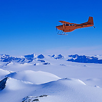 A small, ski-equipped Cessna flies over the  Antarctica's southern Ellsworth Mountains