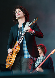 © Licensed to London News Pictures. 18/06/2015. London, UK.   The Strokes performing live at Hyde Park.   In this picture - Nick Valensi (left), Nikolai Fraiture (right).  Photo credit : Richard Isaac/LNP