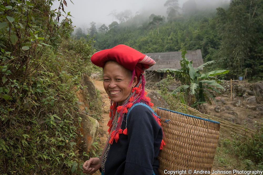 Sa Mei walking on trial to her village Giang ta chai of the Red Dao hill tribe people outside of Sapa, Northern hill tribe areas, Vietnam