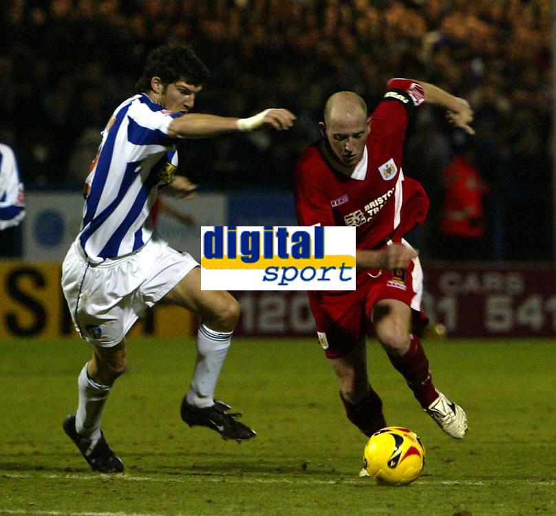 Photo: Chris Ratcliffe.<br />Colchester United v Bristol City. Coca Cola League 1. 17/01/2006.<br />Steve Brooker (R) of Bristol City on the attack..