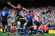 Ian Evans of Wales (l) attempts to charge down Dimitri Yachvili's kick. RBS Six nations champs 2012, Wales v France at the Millennium Stadium in Cardiff, South Wales on Saturday 17th March 2012.  pic by Andrew Orchard, Andrew Orchard sports photography,