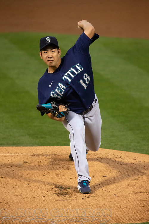 Sep 25, 2020; Oakland, California, USA; Seattle Mariners starting pitcher Yusei Kikuchi (18) delivers a pitch against the Oakland Athletics during the first inning of a Major League Baseball game at Oakland Coliseum. Mandatory Credit: D. Ross Cameron-USA TODAY Sports