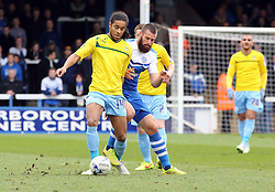 Peterborough United's Michael Bostwick puts pressure on Coventry City's Dominic Samuel - Photo mandatory by-line: Joe Dent/JMP - Mobile: 07966 386802 - 28/03/2015 - SPORT - Football - Peterborough - ABAX Stadium - Peterborough United v Coventry City - Sky Bet League One