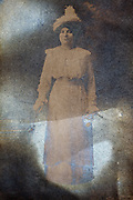 partly silver mirroring photo portrait of an adult woman standing