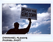 A man holds up a sign during a memorial for Emmanuel Fleming, 34-year-old, and Michael Swift, 46-year-old, in Chicago in this photo taken August 14, 2017. Fleming and Swift were shot on the steps of the Friendship Baptist Church in the 200 block of South Laramie Avenue as they arrived for Sunday service on August 13, 2017. Both men died from multiple gunshot wounds.