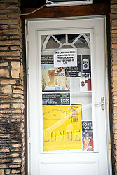 COVID-19 Novel coronavirus forces many business and activities to be postponed, cancelled and closed.  Signs are placed in windows to notify potential patrons of the status