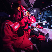 Leg 3, Cape Town to Melbourne, day 03,  Blair Tuke stands by to head up on deck on board MAPFRE. Photo by Jen Edney/Volvo Ocean Race. 14 December, 2017.