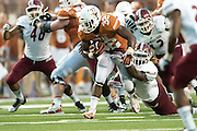 AUSTIN, TX - AUGUST 31: Johnathan Gray #32 of the Texas Longhorns tries to break free against the New Mexico State Aggies on August 31, 2013 at Darrell K Royal-Texas Memorial Stadium in Austin, Texas.  (Photo by Cooper Neill/Getty Images) *** Local Caption *** Johnathan Gray
