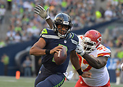 Aug 25, 2017; Seattle, WA, USA; Seattle Seahawks quarterback Russell Wilson (3) is pressured by Kansas City Chiefs defensive end Allen Bailey (97) during a NFL football game at CenturyLink Field.